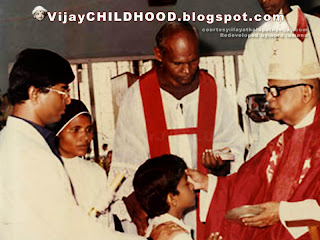 kollywood Tamil super actor vijay  being baptised