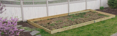 Raised-Garden-Box-Bed-Filled-With-Dirt-and-Mending-Plates