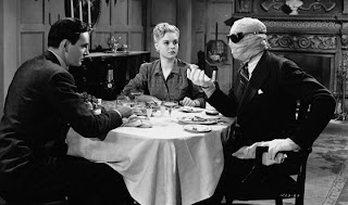 John Sutton (left), Nan Grey and Vincent Price in a scene from The Invisible Man Returns