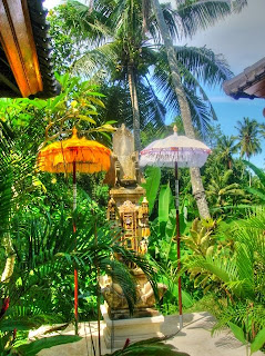 Parasols in the house temple of a boutique hotel in the rice field near Ubud, Bali