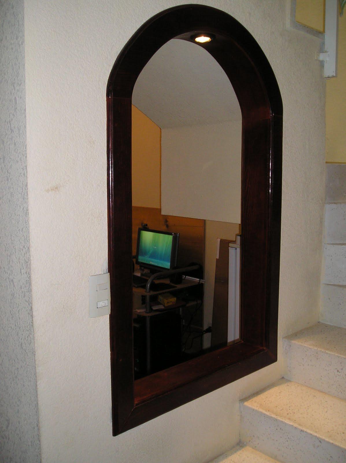 Arco en madera color roble oscuro con iluminacion for Arcos de madera para puertas
