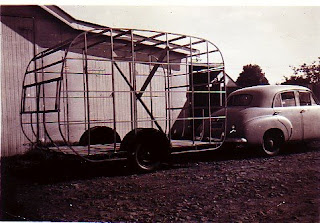Dad's workshop at the rear of the block was freqently occupied by his next big idea necessitating that all vehicles were stowed in the yard. This was his FJ Holden of 1950 and the caravan that he thought he could patent.