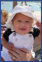 cute smiling baby wears sun hat photo