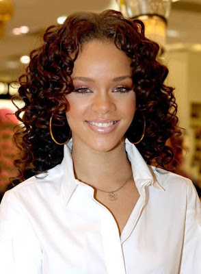 black women curly long wedge shaped hair style.