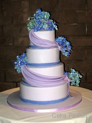 Our bride requested a violet colored four tier wedding cake wrapped around
