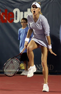 Anna Kournikova played a hit and giggle exhibition
