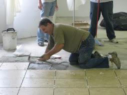 Ron laying tile
