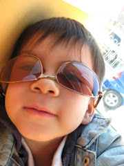 Nino was pretty set in his ways about wearing my sunglasses upside down:)