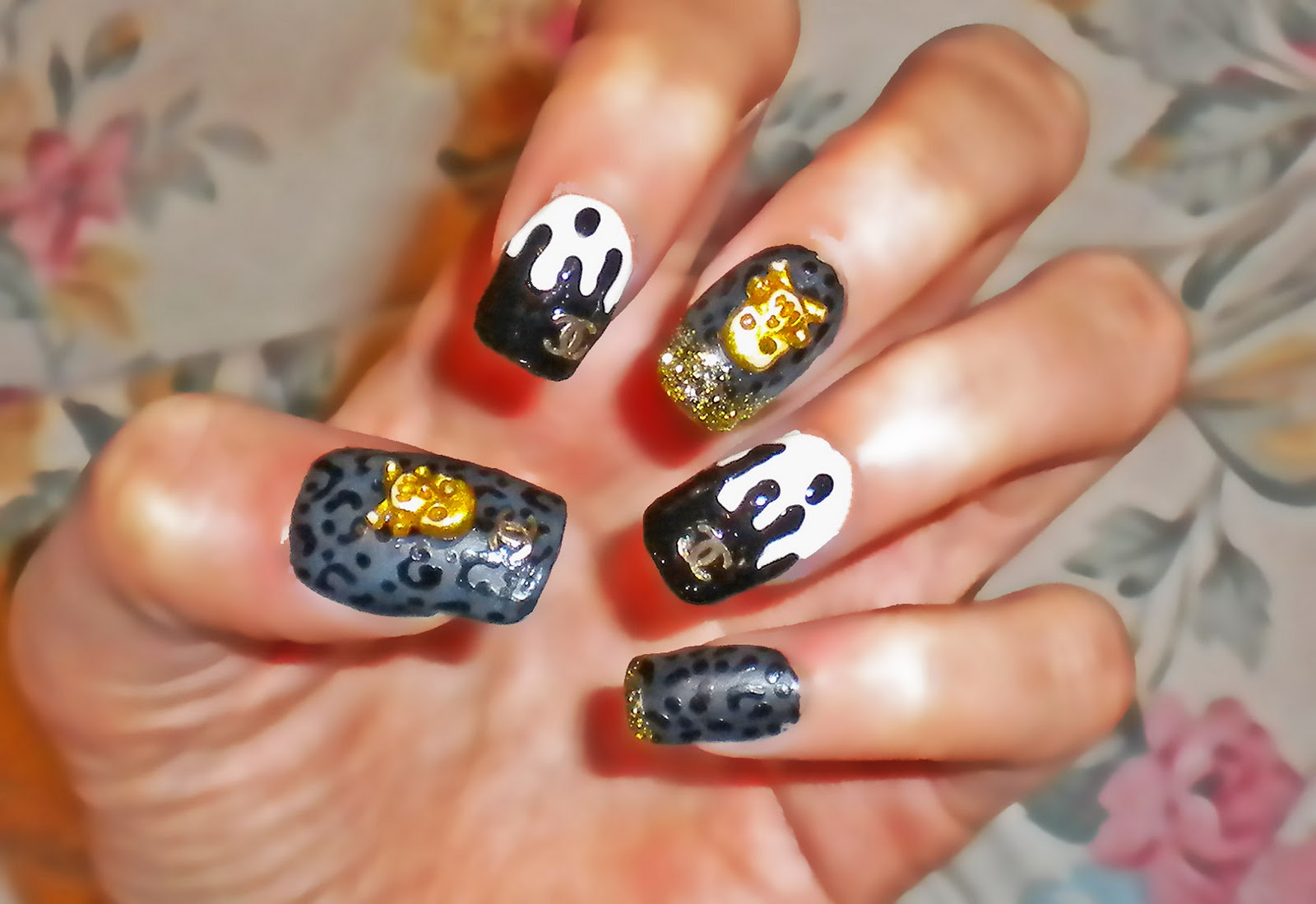 Chanel Nail Tips http://peachykeenstyleblog.blogspot.com/2010/10/skulls-drippy-chanel-and-leopard-print.html