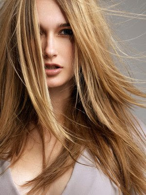 "Blended, ""invisible"" layers are best for long, medium-to-thick hair."