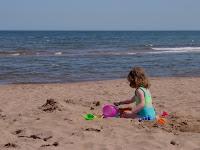 Building sandcastles at Cavendish Beach