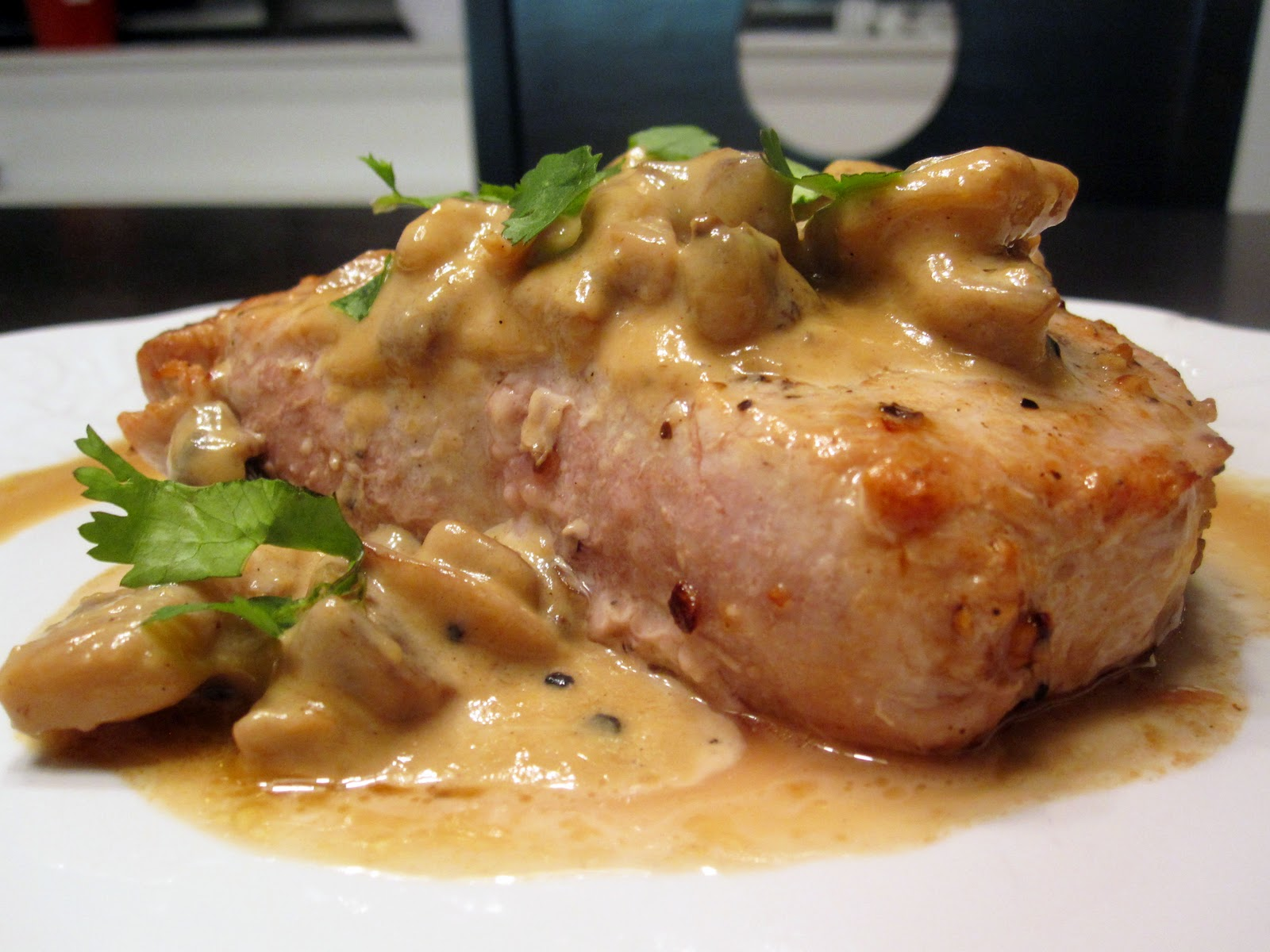 just putzing around the kitchen smothered pork chops