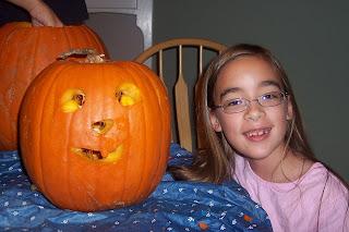 Girl with jack-o-lantern