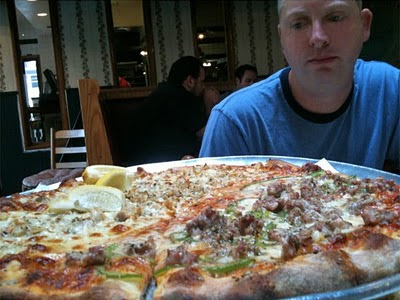 Dave wonders how much progress he can make on this Abate pizza.