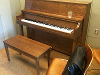 A piano in a practice room in Hendrie Hall