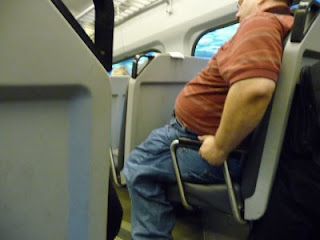 overweight man on train