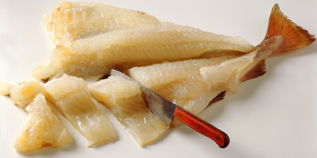 made from aged stockfish (air-dried whitefish) or dried/salted whitefish (klippfisk) and lye (lut). It is gelatinous in texture