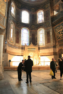 Hagia Sophia museum guard plays with baby