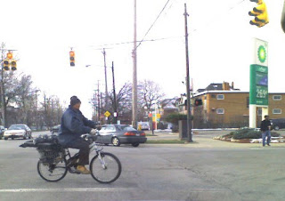 Man biking through Tremont