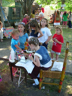 Little Girls wait in line for manicures at ChazFest