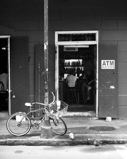 Johnny White's Bar on Bourbon Street with bike out front