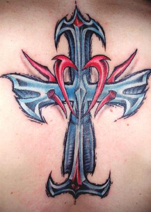 cross tattoo color. Tribal Cross Tattoo Design. The tattoo could have a circle on it
