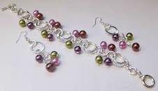 Pulsera de perlas y argollas en baño de plata Cod 2105
