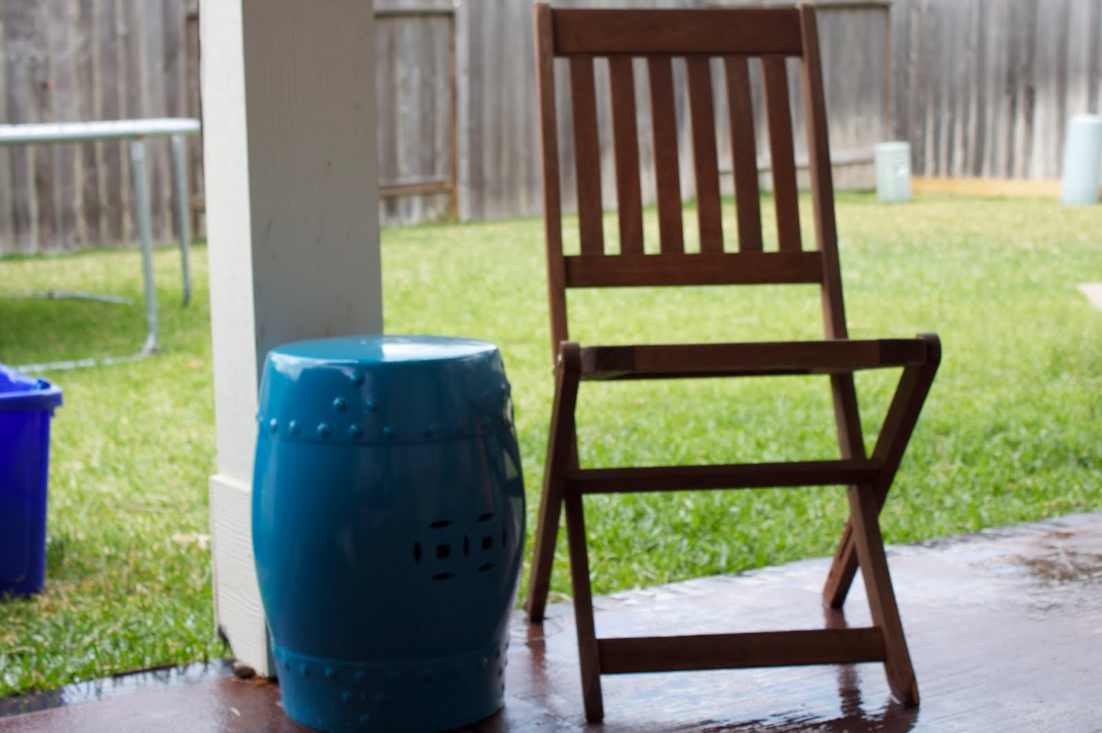Trend This is the Frontgate teak chair I found in the trash It needs a little throw pillow I found the ceramic garden stool at Big Lots for