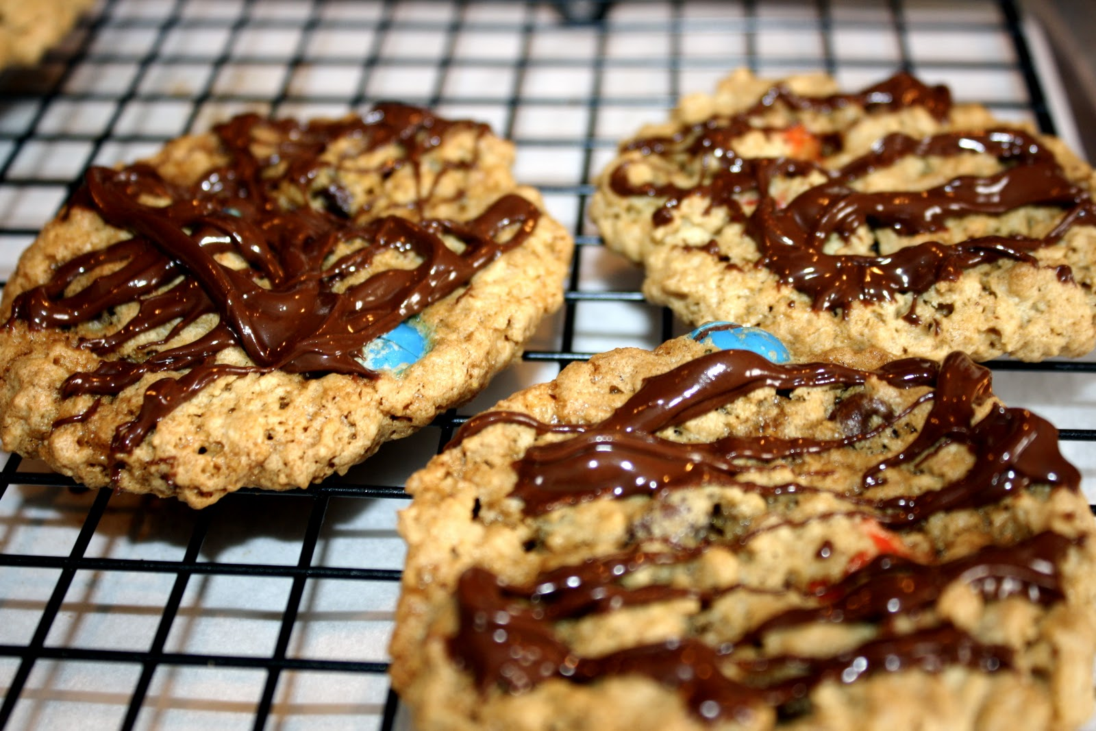 Everyone knows Paula Deen is the queen of desserts...and I love this dessert of hers! Monster cookies. I adapted her recipe slightly with more M&M's and ...
