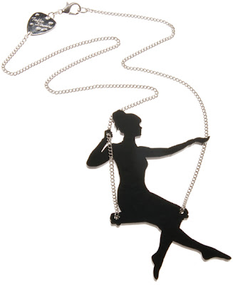Girl necklaces on the swing