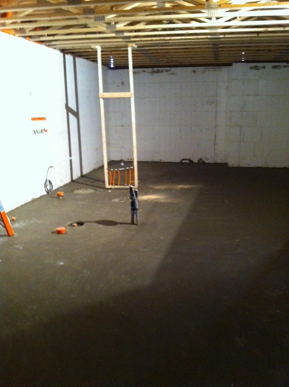 plumbing rough in is done basement floor is poured framing is