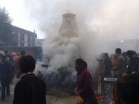 Tibetans burn incense