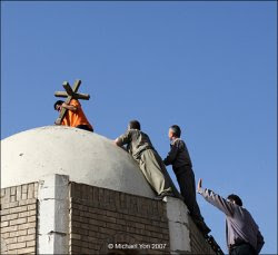 Placing a cross atop the St. John's Church in Baghdad