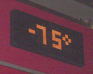 A clock/thermometer display showing a temperature of negative 75 degrees.