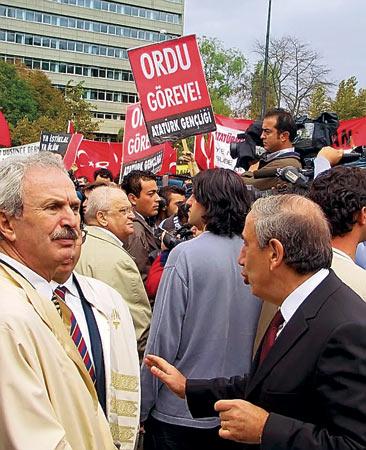 """Kemal Guruz (at right) - Kemal Alemdaroglu (at left) - poster : """"inviting junta to coup d'etat"""""""