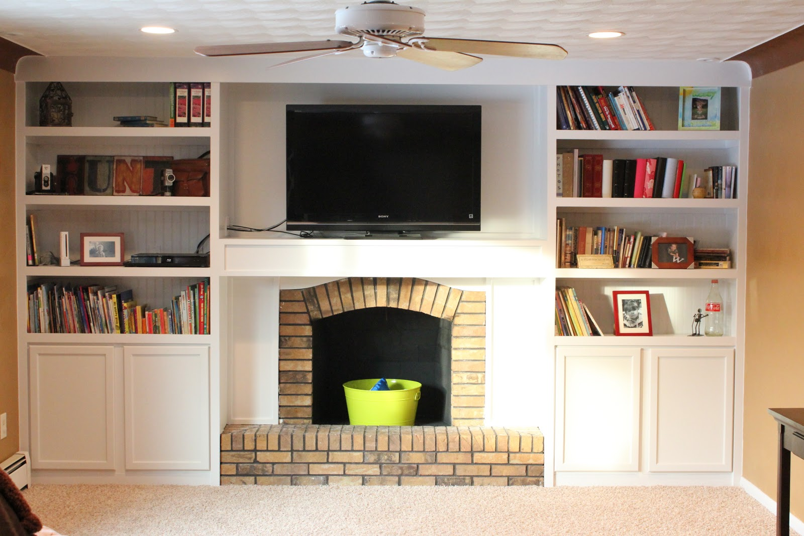 remodelaholic fireplace remodel with built in book shelves