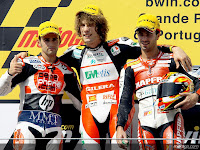 Simoncelli takes win as Bautista crashes, at Estoril.