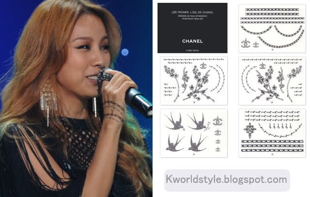 "The tattoo could be those ""Chanel"" paper attachment non-permanent tattoo"