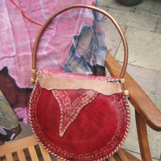 funky leather handbag, funky bag, oval shaped bag, oval shaped leather handbag