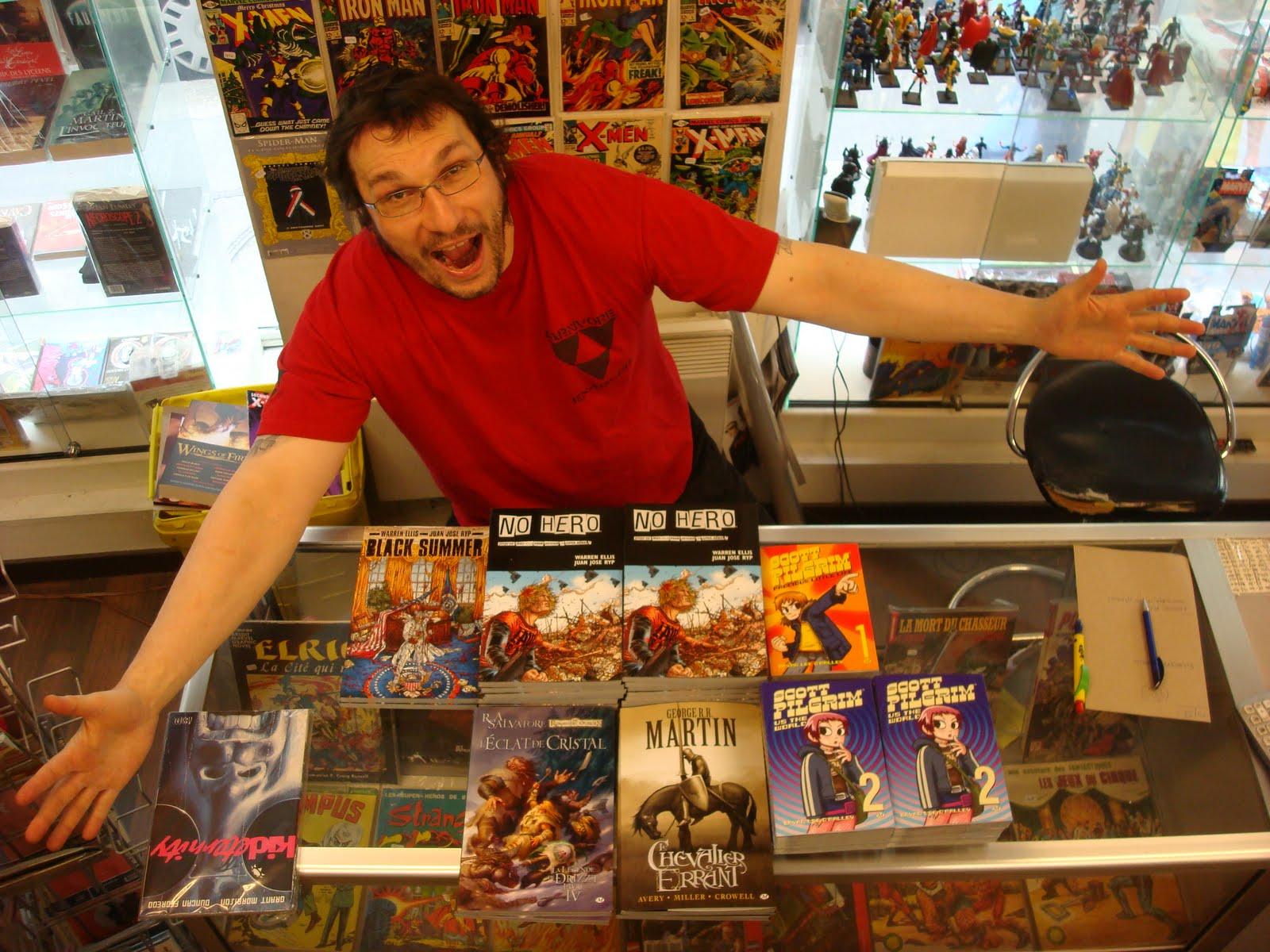 http://2.bp.blogspot.com/_b658hNHs1Sw/TBDCBdji-aI/AAAAAAAAFHk/ZILoOw52Ctw/s1600/Geg+Maga+extatique+devant+les+nouveaut%C3%A9s+Milady+Graphics+%C3%A0+Arkham+Comics+7+rue+Broca+75005+Paris.JPG