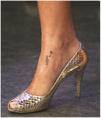 number 883 and Hilary Duff has a tiny little anchor tattoo on her ankle.