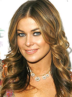 dark brown hair with caramel highlights. dresses dark rown hair with