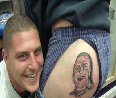 Getting a tattoo of your best buddies face on your ass is taking stupidity