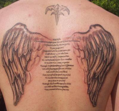 Angel Wings Tattoo On Ladies Back cross with angel wings tattoo.