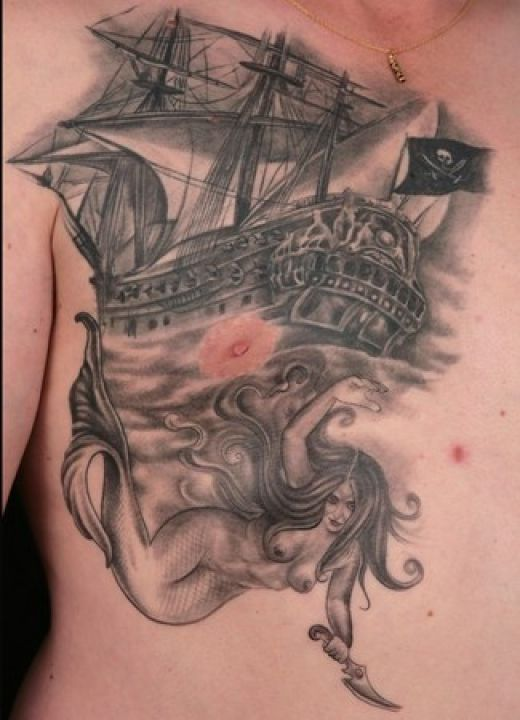 Classic pirate ship tattoo with woman.