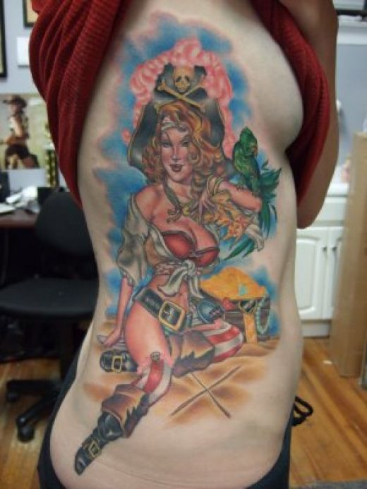 Pirate girl tattoo with parrot and treasure chest.