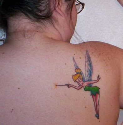 Tinkerbell with wand tattoo on back.