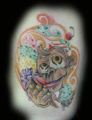 Cartoon monkey with ice cream tattoo.