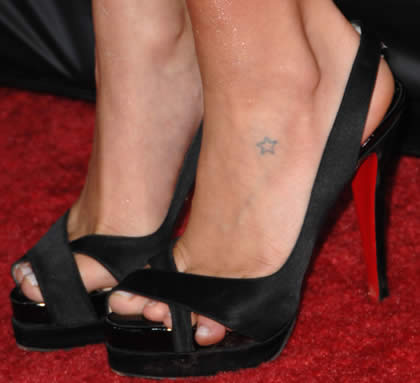 stars tattoos on foot. small star tattoo on foot.