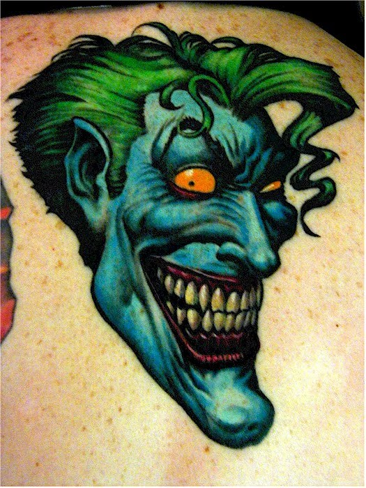 Cartoon joker tattoo.